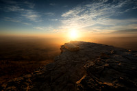 Sunrise over the cliff of the Ramon Crater in Israel by photographer Tom Shapira