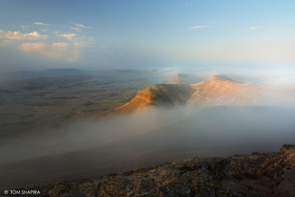 Fog sweeping into Yeruham Crater in the Negev Desert, Israel (Landscape Image).