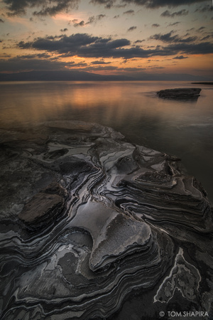 Landscape image from the dead sea in Israel showing layers of mud, by photographer Tom Shapira